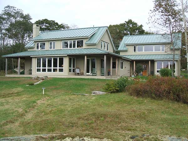 Standing seam metal roofs by c o beck sons roofing for Tin roof homes